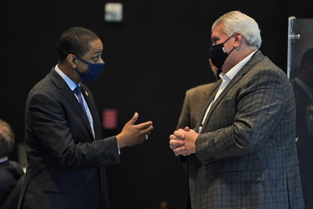 Virginia Lt. Gov., Justin Fairfax, left, speaks with new State Sen. Travis Hackworth, R-Tazewell, during the Senate reconvene session at the Science M...