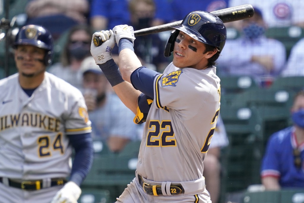 Milwaukee Brewers' Christian Yelich watches after hitting a double against the Chicago Cubs during the fourth inning of a baseball game in Chicago, We...