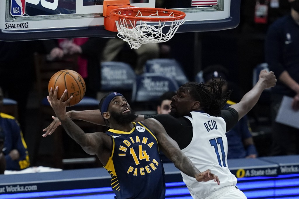 Indiana Pacers' JaKarr Sampson (14) goes up for a dunk against Minnesota Timberwolves' Naz Reid (11) during the first half of an NBA basketball game, ...