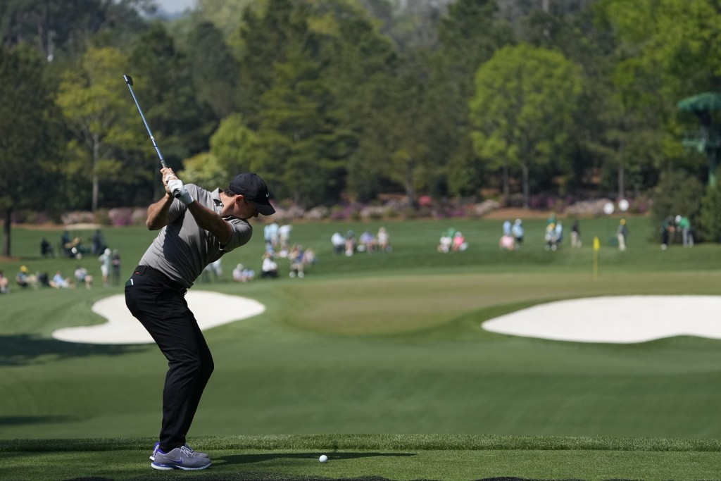 Rory McIlroy, of Northern Ireland, tees off on the fourth hole during a practice round for the Masters golf tournament on Wednesday, April 7, 2021, in...