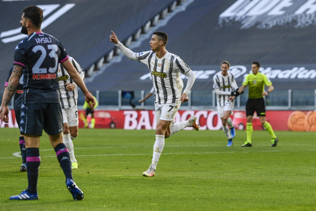 Juventus' Cristiano Ronaldo celebrates after scoring his team's first goal during the Italian Serie A soccer match between Juventus and Napoli at the ...