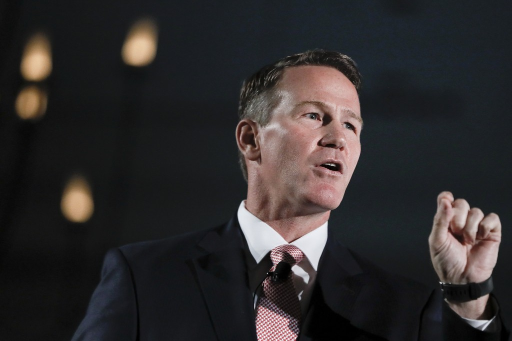 FILE - In this Oct. 16, 2018, file photo Jon Husted speaks at the Columbus Chamber of Commerce Government Day in Cincinnati, Ohio. Now the current Ohi...