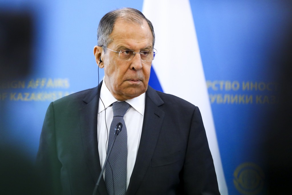 In this handout photo released by Russian Foreign Ministry Press Service, Russian Foreign Minister Sergey Lavrov listens to a journalist's question du...