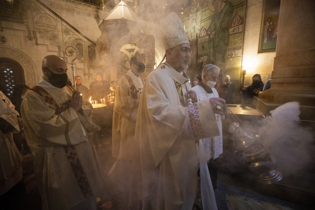 Latin Patriarch of Jerusalem Pierbattista Pizzaballa leads the Holy Saturday Easter Vigil procession in the Church of the Holy Sepulchre, traditionall...