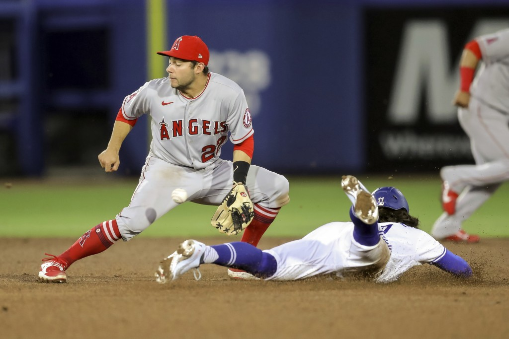 Los Angeles Angels second baseman David Fletcher cannot handle the throw as Toronto Blue Jays' Bo Bichette steals second base during the sixth inning ...