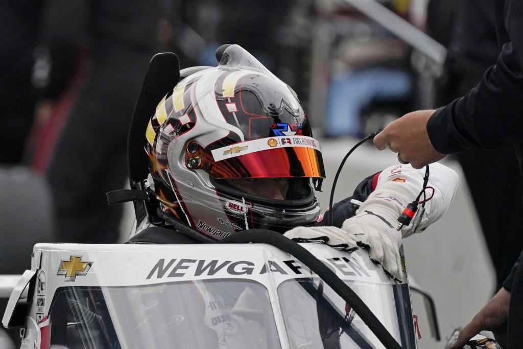 Josef Newgarden climbs into his car during testing at the Indianapolis Motor Speedway, Thursday, April 8, 2021, in Indianapolis. (AP Photo/Darron Cumm...