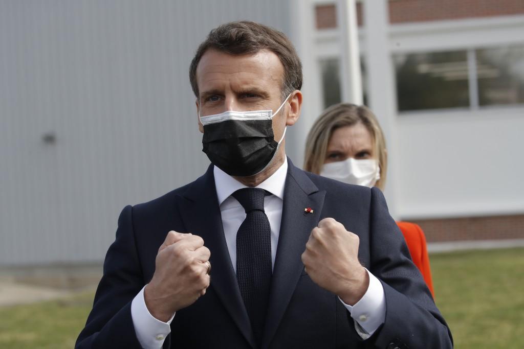 French President Emmanuel Macron reacts after visiting the Delpharm plant in Saint-Remy-sur-Avre, west of Paris, Friday, April 9, 2021 in Paris. The D...