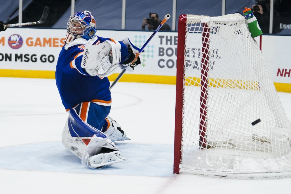 New York Islanders goaltender Ilya Sorokin (30) reacts to a shot on the goal during the first period of an NHL hockey game against the Philadelphia Fl...