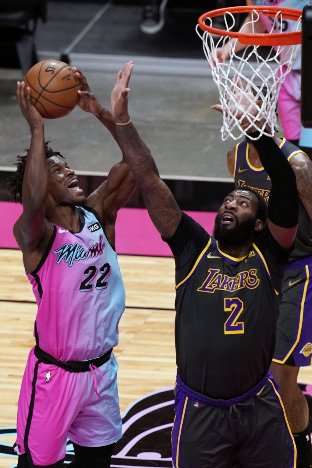 Miami Heat forward Jimmy Butler (22) drives to the basket as Los Angeles Lakers center Andre Drummond (2) defends, during the second half of an NBA ba...