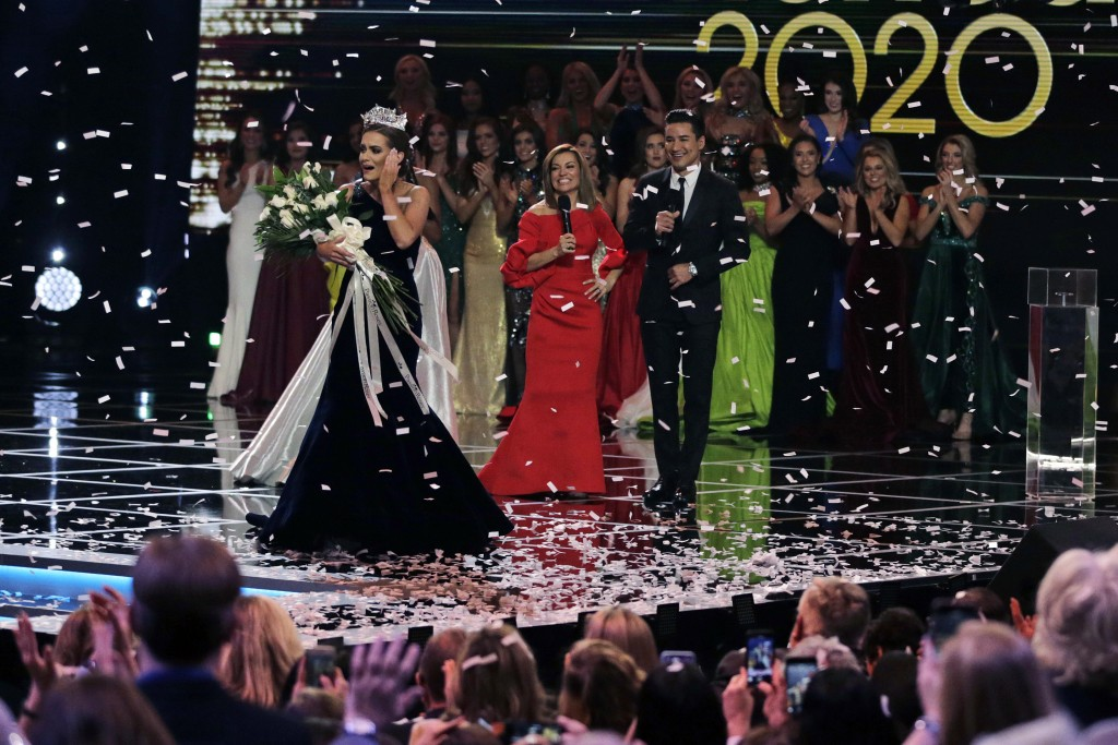 FILE - In this Dec. 19, 2019, file photo, Camille Schrier, of Virginia, left, reacts after winning the Miss America competition at the Mohegan Sun cas...
