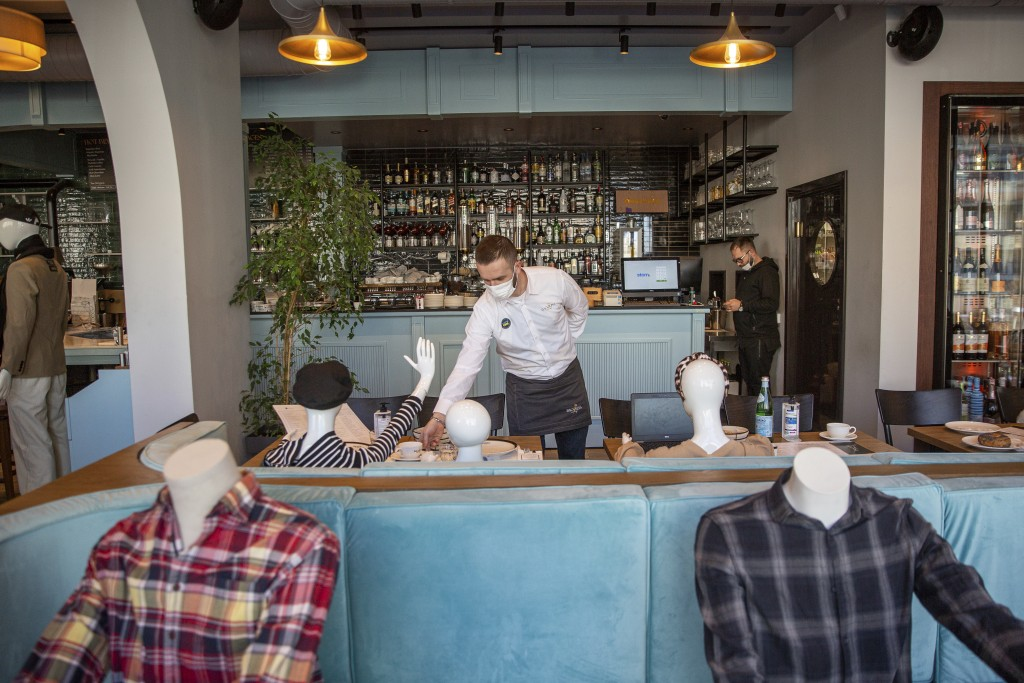 Mannequins are positioned at the tables of Bagolina eatery restaurant, as a protest against the latest government COVID-19 lockdown measures in Kosovo...