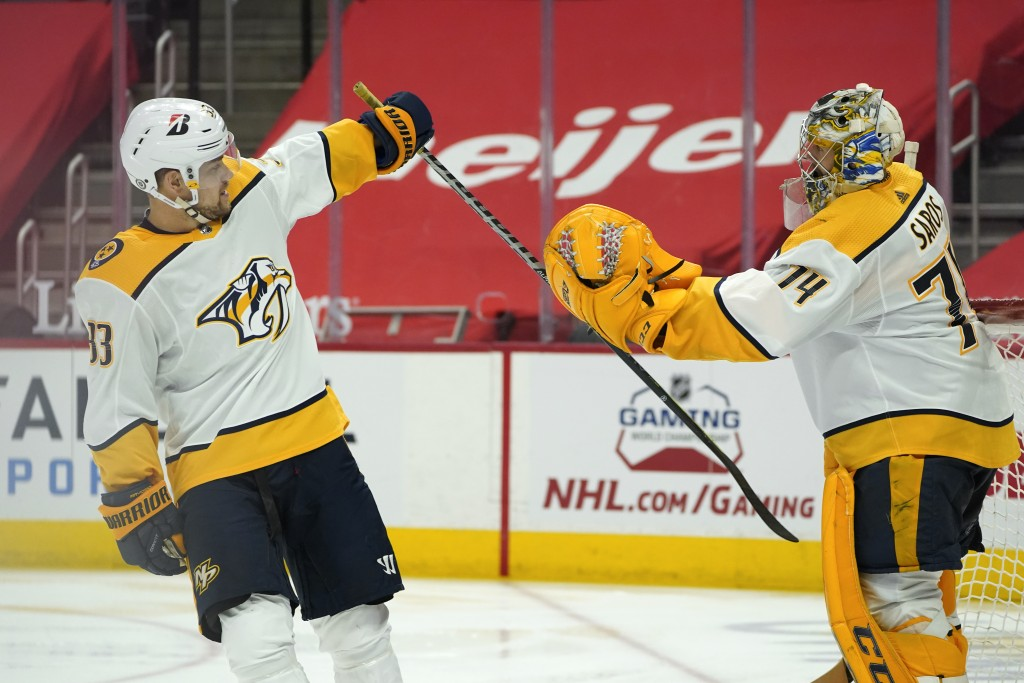 Nashville Predators right wing Viktor Arvidsson (33) celebrates his goal against the Detroit Red Wings with goaltender Juuse Saros (74) in the second ...