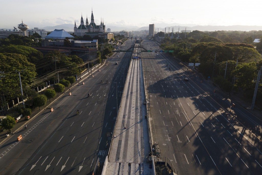 Motorist traverse an almost empty Commonwealth Avenue as the government implements a strict lockdown to prevent the spread of the coronavirus on Good ...