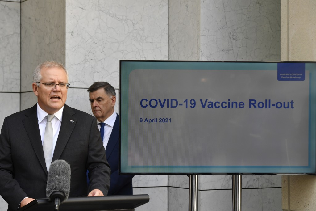 Australian Prime Minister Scott Morrison, left, addresses the media at a press conference as Department of Health Secretary Dr Brendan Murphy watches ...
