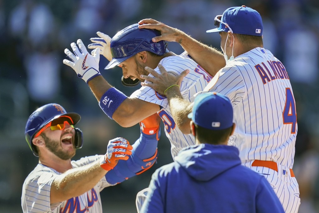 New York Mets' Michael Conforto (30) celebrates after being hit by a pitch and scoring the winning run on loaded bases during the ninth inning of a ba...