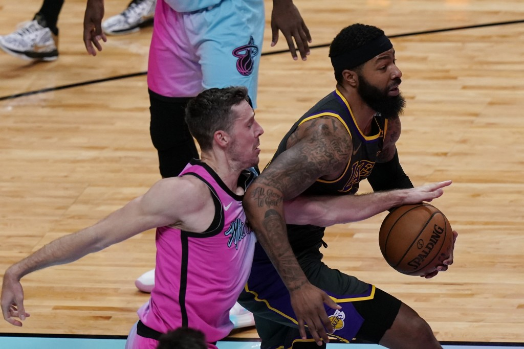 Miami Heat guard Goran Dragic (7) defends Los Angeles Lakers forward Markieff Morris (88), during the first half of an NBA basketball game, Thursday, ...