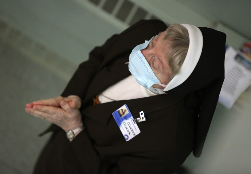 Sister Mary Charlene Ozanick, of the Felician Sisters of North America, prays during morning Mass at St. Anne Home in Greensburg, Pa., on Thursday, Ma...