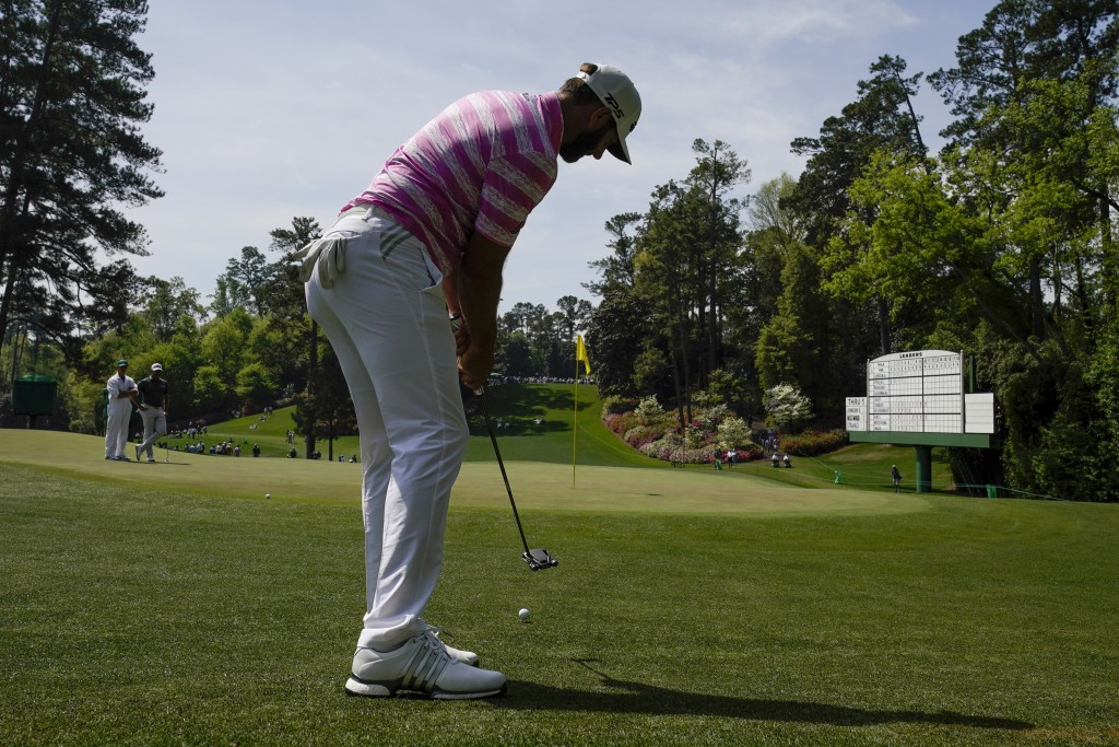 Dustin Johnson putts from off the sixth green during the first round of the Masters golf tournament on Thursday, April 8, 2021, in Augusta, Ga. (AP Ph...