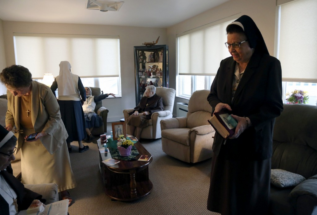 Nuns of the Felician Sisters of North America conclude morning prayers at St. Anne Home in Greensburg, Pa., on Thursday, March 25, 2021. Last October ...