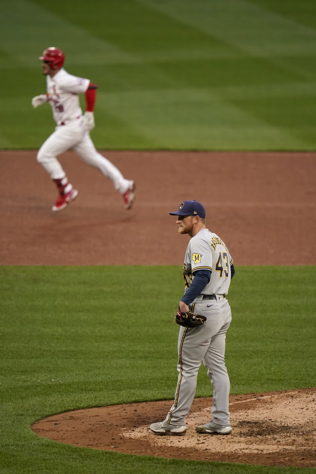 St. Louis Cardinals' Nolan Arenado, top, rounds the bases after hitting a two-run home run off Milwaukee Brewers relief pitcher Drew Rasmussen (43) du...