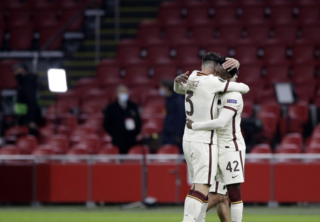 Roma's Roger Ibanez, left, celebrates with Roma's Amadou Diawara at the end of the Europa League first leg quarterfinal soccer match between Ajax and ...
