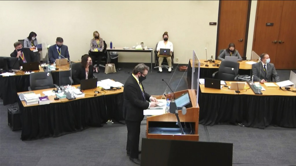 In this image taken from video, defense attorney Eric Nelson questions witness Daniel Isenschmid, a forensic toxicologist as Hennepin County Judge Pet...