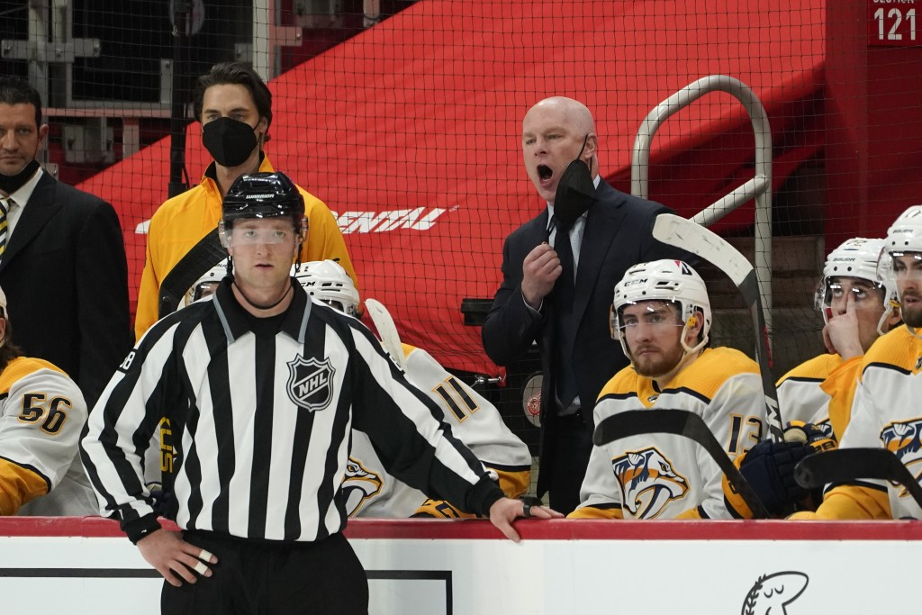Nashville Predators head coach John Hynes argues a boarding call against the Detroit Red Wings in the second period of an NHL hockey game Thursday, Ap...