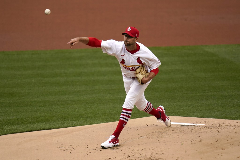 St. Louis Cardinals starting pitcher Adam Wainwright throws during the first inning of a baseball game against the Milwaukee Brewers Thursday, April 8...