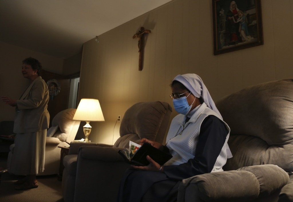 Sister Rose Nellivila sits for morning prayer at St. Anne Home in Greensburg, Pa., where she serves as a nurse for residents of the nursing facility, ...