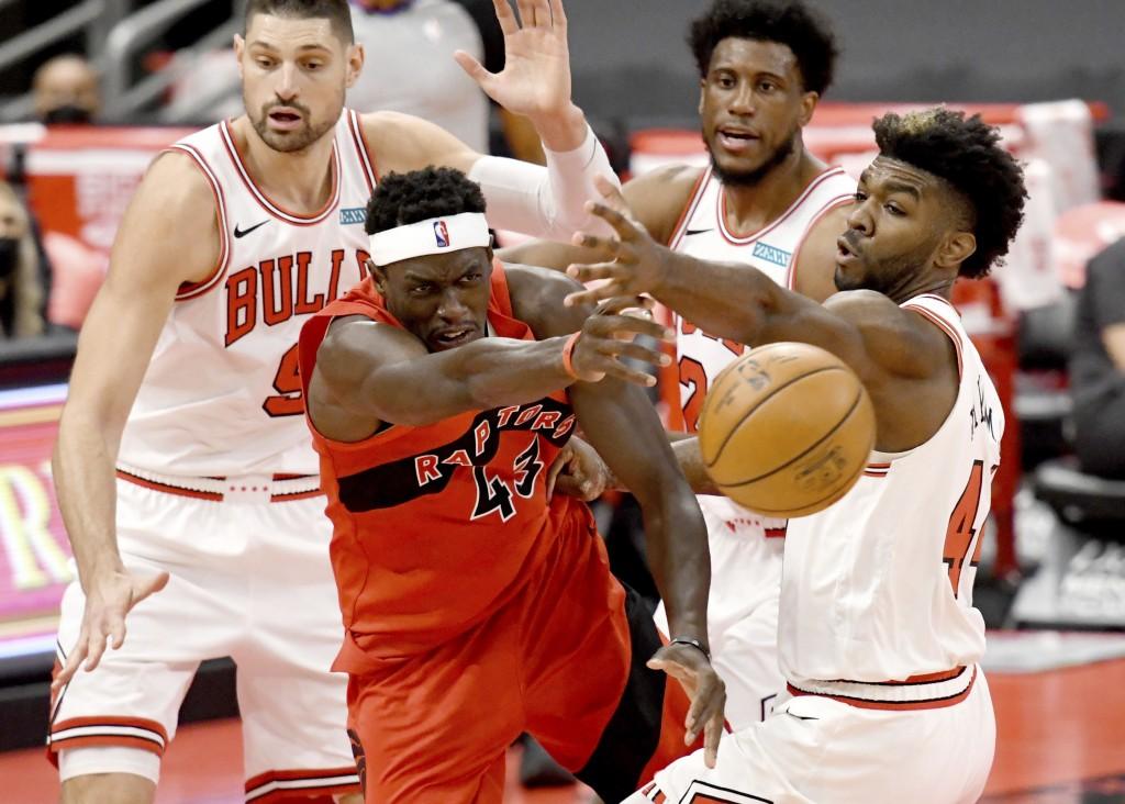 Toronto Raptors forward Pascal Siakam (43) passes the ball past Chicago Bulls' Patrick Williams, right, during the second half of an NBA basketball ga...