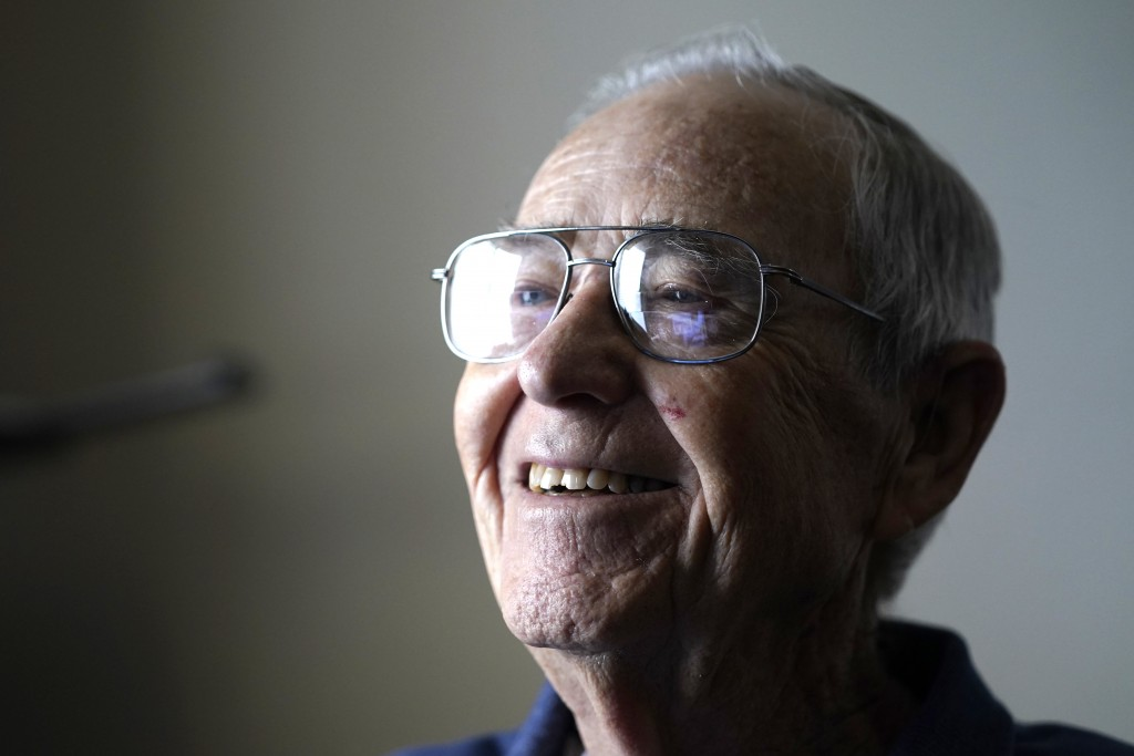 """Victor Hamilton smiles as he talks about his late wife, Nancy """"Nicki"""" Hamilton, who died about a year earlier after contracting COVID-19 at a choir pr..."""