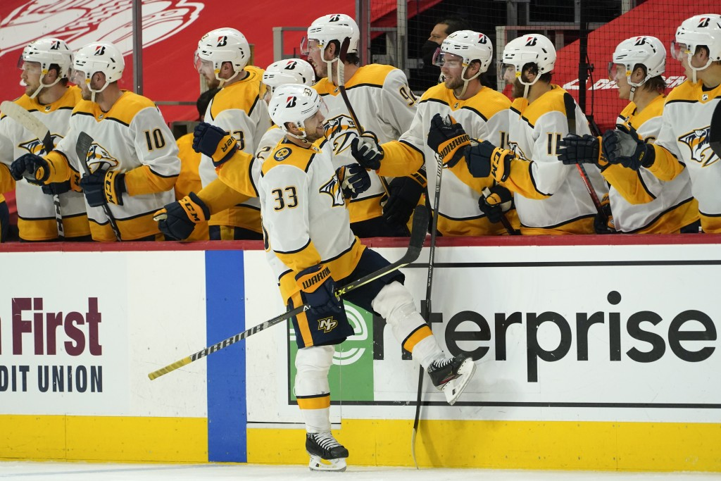 Nashville Predators right wing Viktor Arvidsson (33) celebrates his goal against the Detroit Red Wings in the second period of an NHL hockey game Thur...