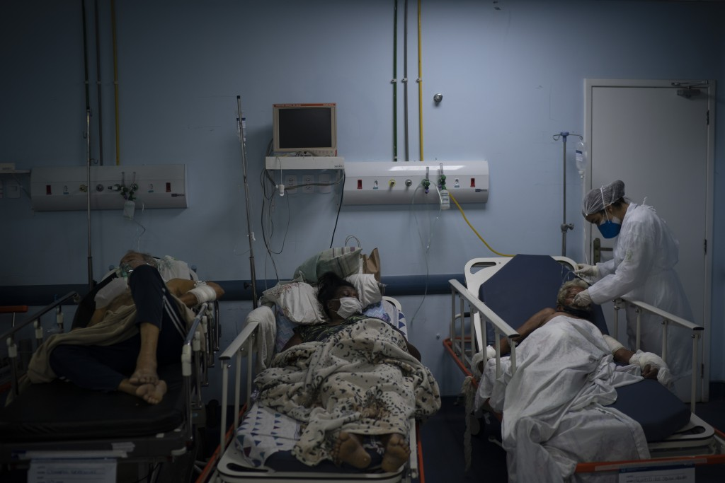 Patients waiting for test results are treated in a temporary room before being moved to a COVID-19 area of the municipal hospital in Sao Joao de Merit...