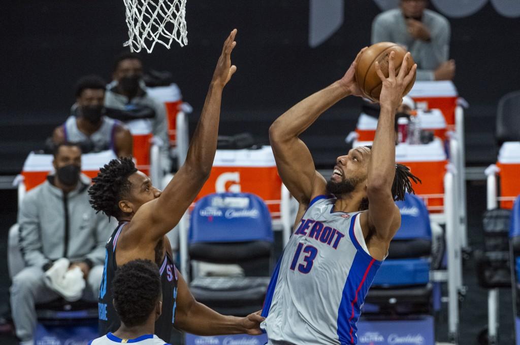 Detroit Pistons center Jahlil Okafor (13) shoots over Sacramento Kings center Hassan Whiteside during the first quarter of an NBA basketball game in S...
