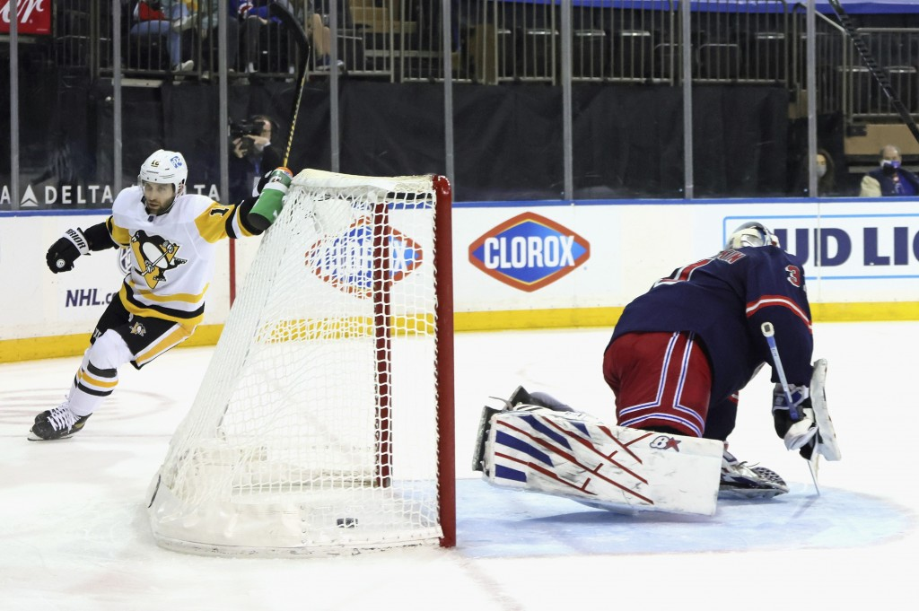 Pittsburgh Penguins' Jason Zucker (16) scores a goal against New York Rangers' Igor Shesterkin (31) during the third period of an NHL hockey game Thur...