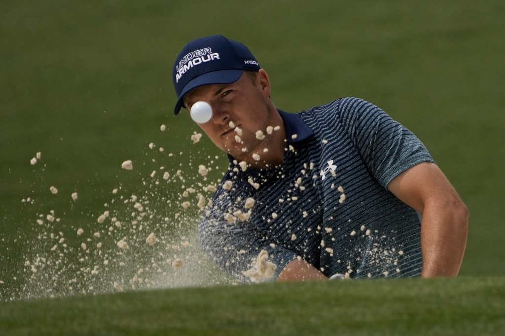 Jordan Spieth hits out of a bunker on the second hole during the first round of the Masters golf tournament on Thursday, April 8, 2021, in Augusta, Ga...