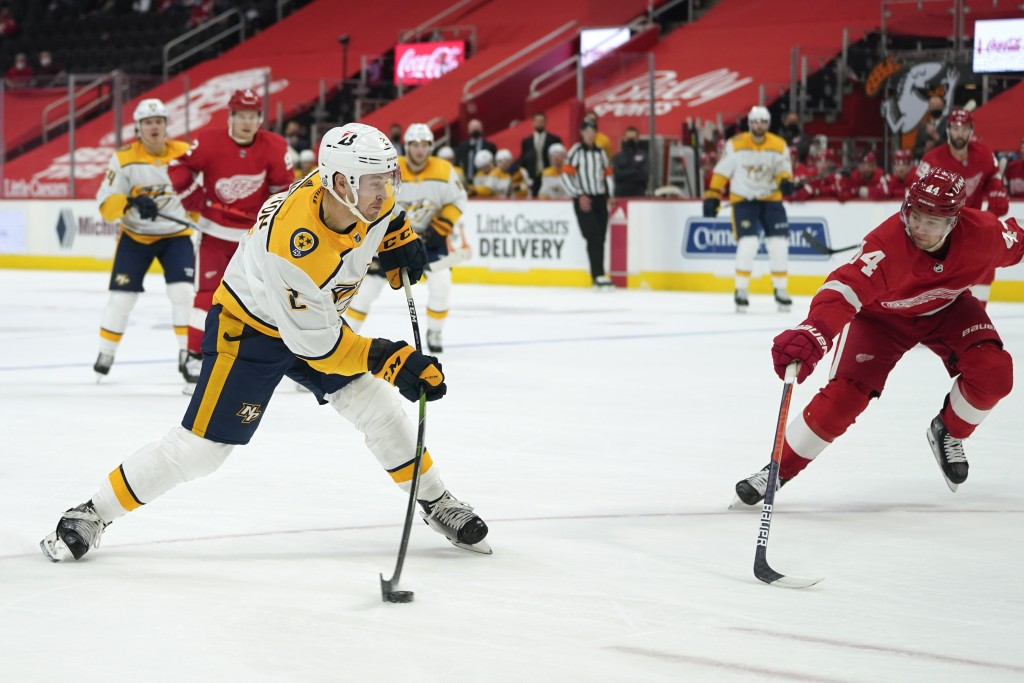 Nashville Predators defenseman Tyler Lewington (2) shoots as Detroit Red Wings defenseman Christian Djoos (44) defends in the first period of an NHL h...
