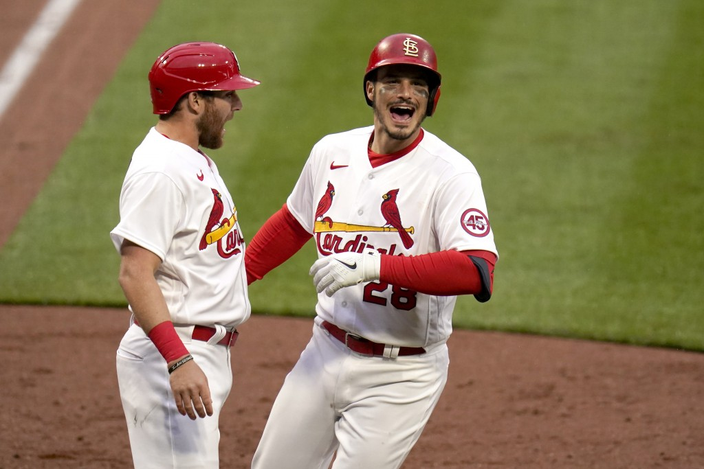 St. Louis Cardinals' Nolan Arenado, right, is congratulated by teammate Austin Dean after hitting a two-run home run during the eighth inning of a bas...