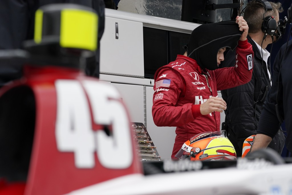 Santino Ferrucci waits in his pits during testing at the Indianapolis Motor Speedway, Thursday, April 8, 2021, in Indianapolis. (AP Photo/Darron Cummi...