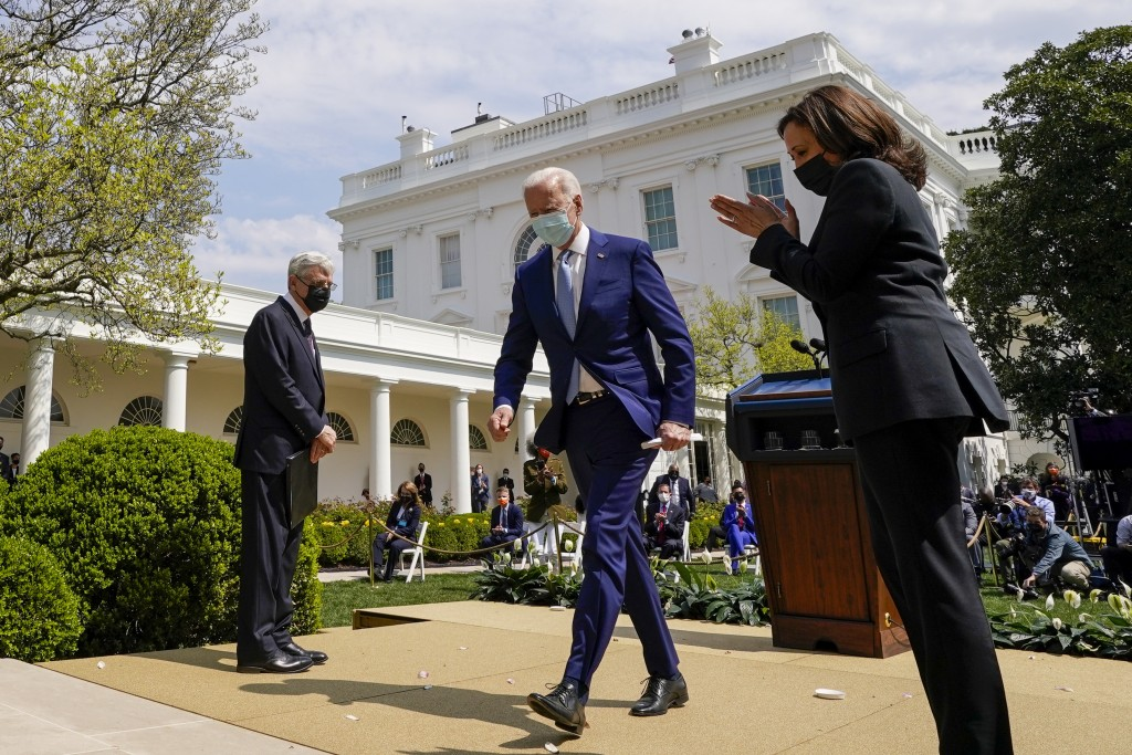 President Joe Biden, accompanied by Vice President Kamala Harris, right, and Attorney General Merrick Garland, left, departs after speaking about gun ...