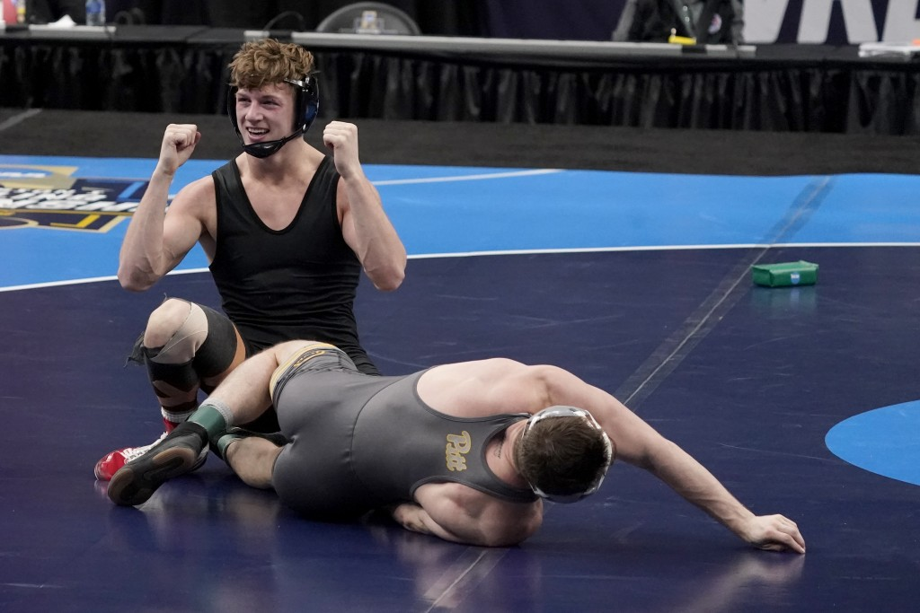 FILE - Stanford's Shane Griffith celebrates after defeating Pittsburgh's Jake Wentzel during their 165-pound match in the finals of the NCAA wrestling...