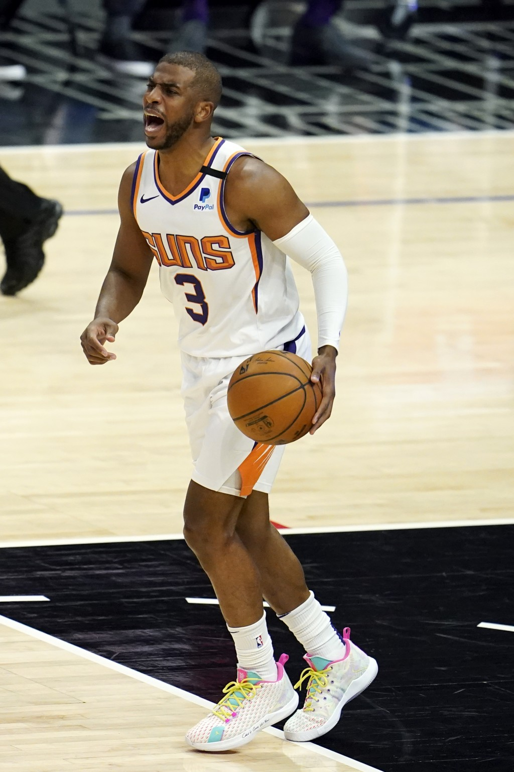 Phoenix Suns guard Chris Paul yells out instructions as he dribbles during the first half of an NBA basketball game against the Los Angeles Clippers T...