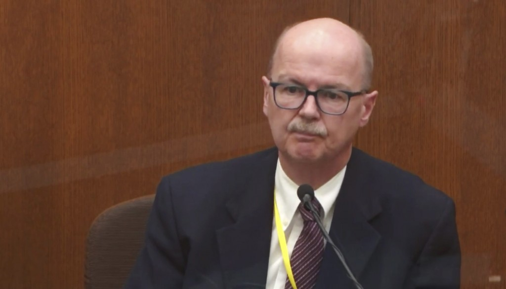 In this image taken from video witness Daniel Isenschmid, a forensic toxicologist testifies as Hennepin County Judge PeterCahill presides, Thursday, ...