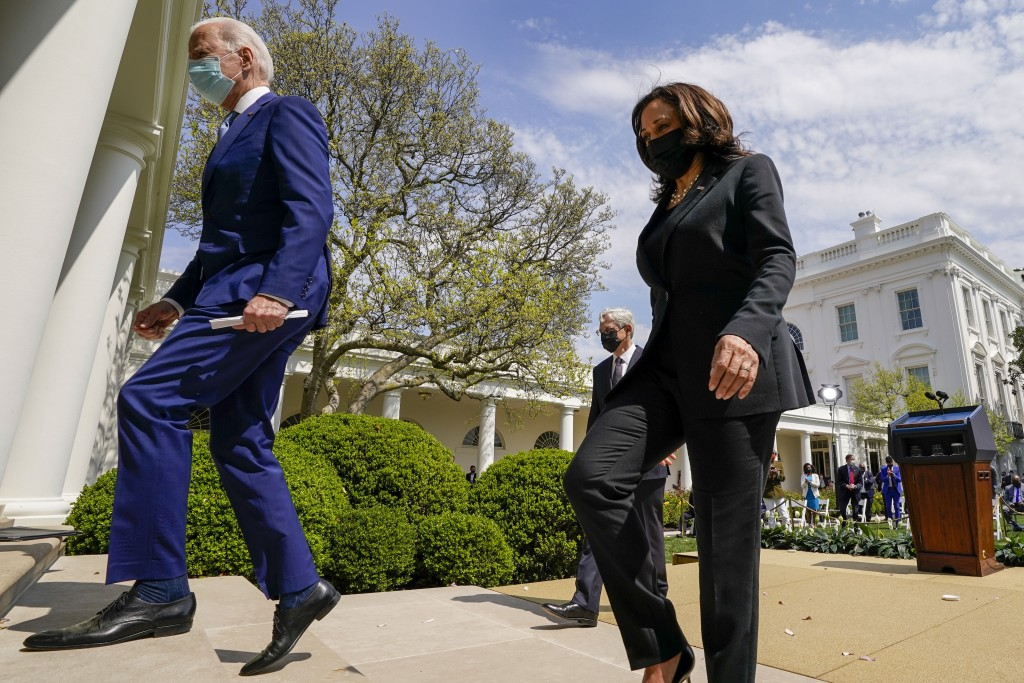 President Joe Biden, accompanied by Vice President Kamala Harris, right, and Attorney General Merrick Garland, second from right, departs after speaki...