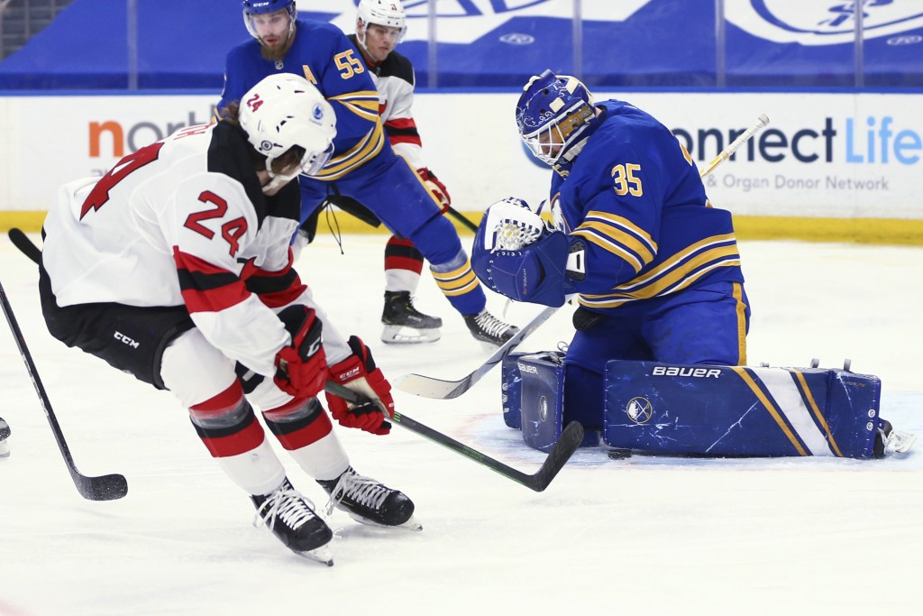 Buffalo Sabres goalie Linus Ullmark (35) stops New Jersey Devils defenseman Ty Smith (24) during the first period of an NHL hockey game Thursday, Apri...