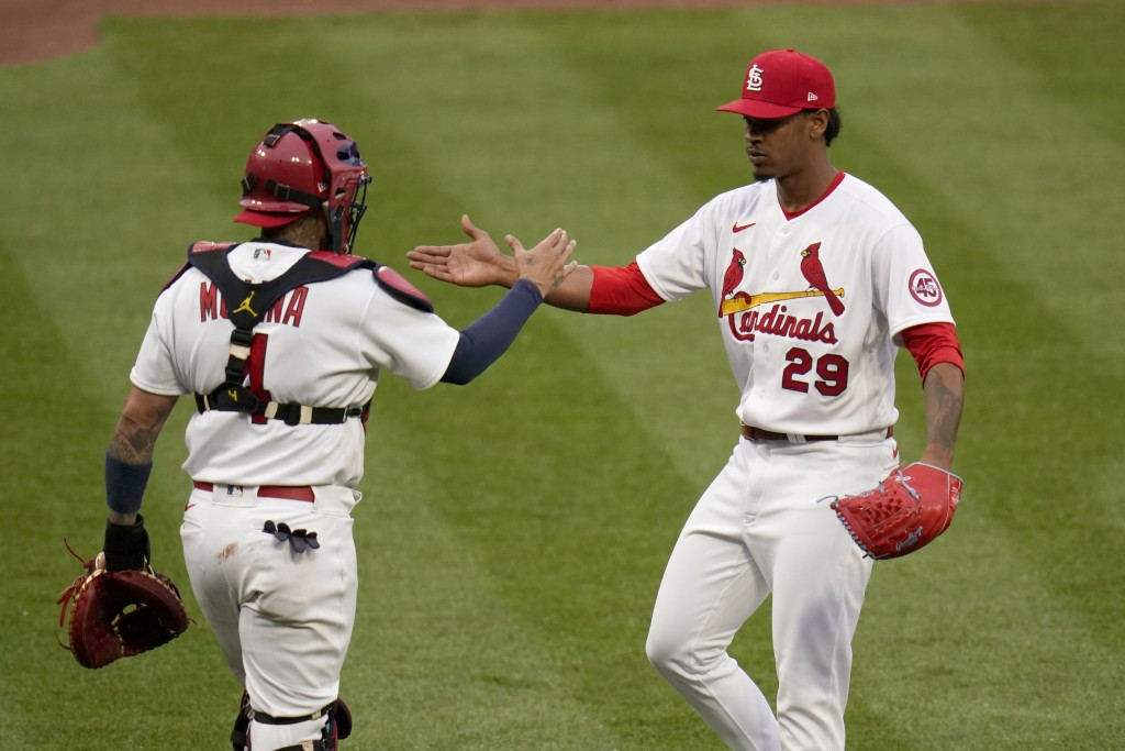 St. Louis Cardinals relief pitcher Alex Reyes (29) and catcher Yadier Molina (4) celebrate after defeating the Milwaukee Brewers in a baseball game Th...
