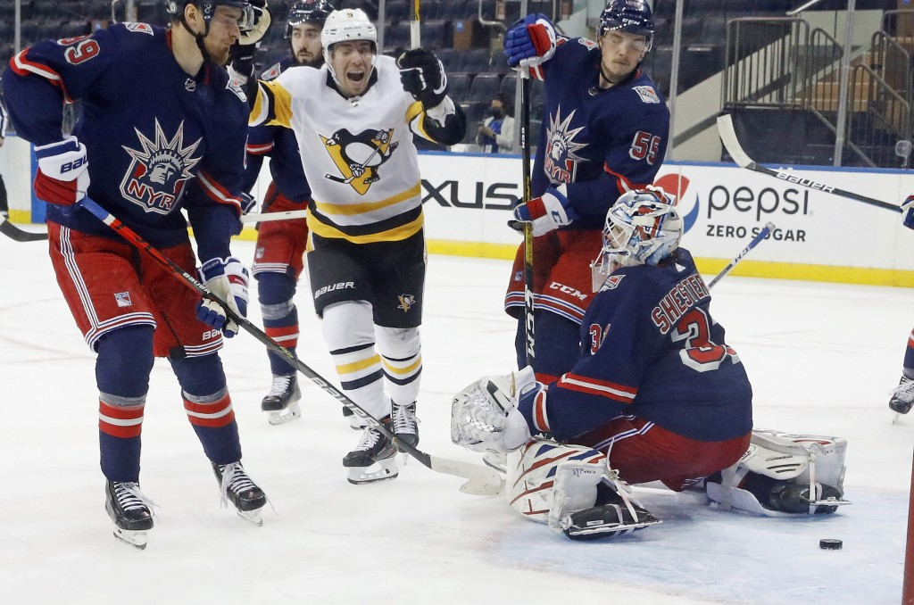 Pittsburgh Penguins' Evan Rodrigues (9) scores on a power-play against New York Rangers' Igor Shesterkin (31) during the second period of an NHL hocke...