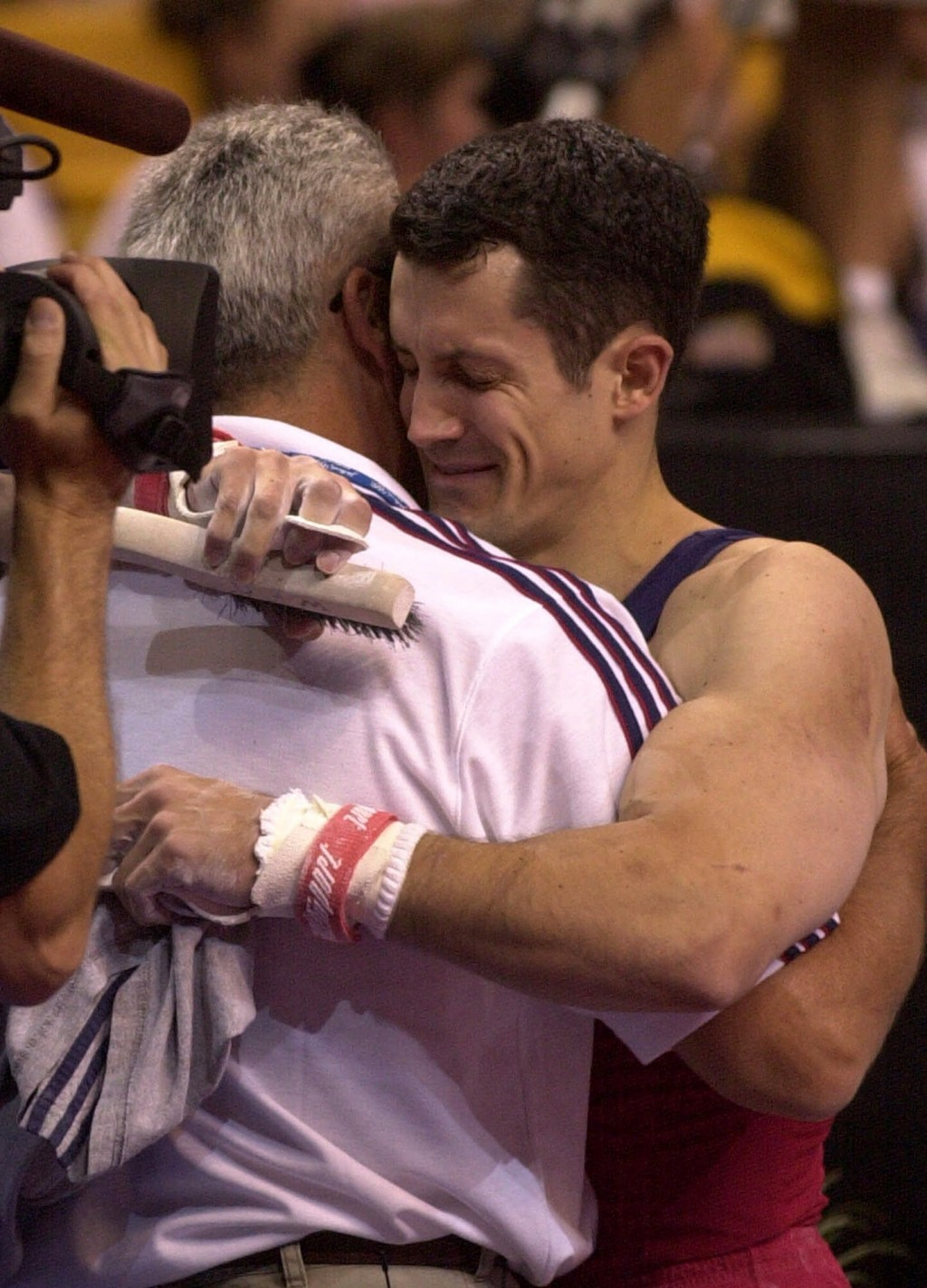 FILE - John Roethlisberger, of Falcon Heights, Minn., hugs his dad Fred after his final event in the men's 2000 U.S. Olympic Gymnastics Trials in Bost...