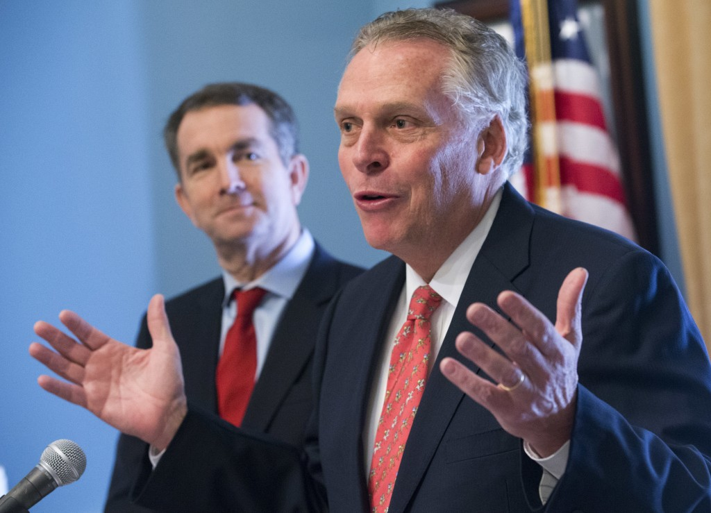 FILE - In this Jan. 9, 2018, file photo, former Virginia Gov. Terry McAuliffe, right, speaks to the media along with Gov. Ralph Northam at the Capitol...