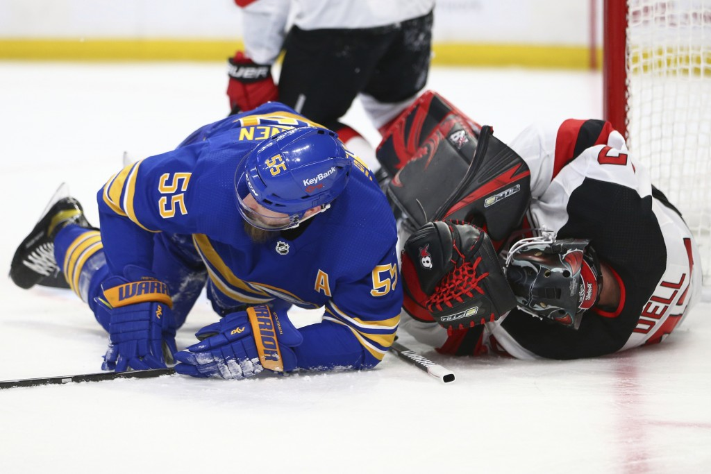 Buffalo Sabres defenseman Rasmus Ristolainen (55) and New Jersey Devils goalie Aaron Dell (47) collide during the second period of an NHL hockey game ...